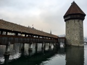 "The stone tower, which was built in 1300, remained undamaged by the blaze. It's known as the Wasserturm (""water tower""), not because it's a pumping station, but simply because it's standing in water. Notice that it sits on the side of the bridge that fronts the lake. That's because enemy attacks usually came from Lake Luzern, which empties into the Reuss River at this point. As part of the Medieval defense system, the tower also acted as a prison and torture chamber."