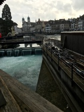 Alongside and beyond the Spreuerbrücke, you can see part of the Ruess River's weir system. The city of Luzern has the big job of controlling the outflow of water from Lake Luzern down through the Reuss River. The goal is to keep the water at a level where boats can still operate safely on the lake.