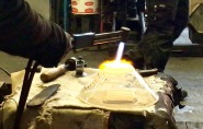 For the final step, the glassblower smooths the bottom of his bowl using a blowtorch.