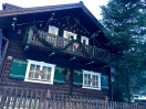 Check out this adorable house complete with hunting trophies bedecking its exterior.