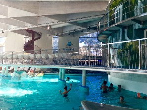 "In the back, you can see ""Family World,"" where kids and parents can enjoy water slides and a lazy river."