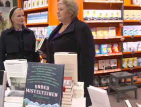One of the hosts of the show joined Prime Minister Erna Solberg as she shopped for Christmas gifts in a bookstore. Not kidding.