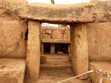 Peering through this classic trilithon doorway, you can see the altar that gets lit up by the sun's rays on the equinoxes.