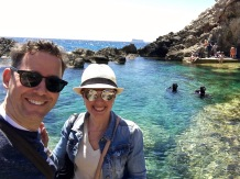 "The coastline of Malta is dotted with beaches for those wanting to explore the extraordinary greenish-blue waters surrounding the island. Behind us is Ghar Lapsi, a natural ""swimmin' hole"" for hard-core water enthusiasts like the divers seen here, or just plain toe-dippers."
