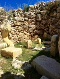 """The first apse on your right-hand side contains parts of the """"torba"""" floor, which steps up through a series of standing stones. Torba is a kind of plaster floor made from crushed limestone that's spread over rubble, then wetted and beaten until it forms a shiny, hard surface -- ancient linoleum ;)"""