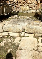 "Notice the central corridor's flagstone paving and the ""libation hole"" in the threshold that steps up to the central apse at the head of the South Temple. Archaeologists think that priests or priestesses may have poured water -- as well as blood from animal sacrifices -- through these holes into the earth during seasonal rituals to ensure a good harvest and an increasing herd."