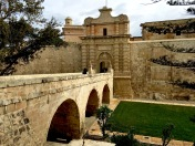 "In 1724, the Knights Hospitallers built the fancy Main Gate still used today to enter Mdina. But if you look closely, on the right side you'll see the much older Medieval gate, which was walled up when the new gate was built. P.S. If the gate looks familiar, it might be because you're a ""Game of Thrones"" fan."