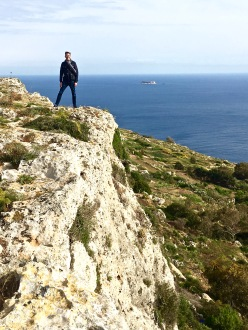 Matthew perches atop the gravity-defying Dingli Cliffs. You can hike along the escarpment for a bird's-eye view of the Mediterranean and the tiny, uninhabited island of Fifla, barely visible in the distance.