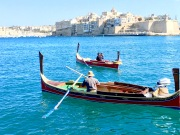 "The ancient Phoenicians also made their mark in Malta. These water taxis called ""dghajsa"" retain their traditional Phoenician shape, color, and guardian ""evil-eye"" motif on the bow of the boat."