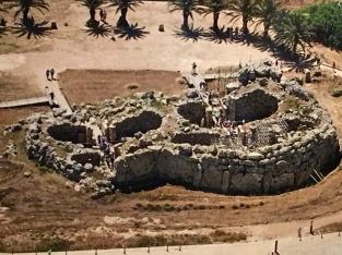 An aerial shot reveals the construction methods and beehive nature of the Ġgantija Temple Complex. An outer wall surrounds the two temples, their inner walls define their individual, D-shaped lobes or apses, and the space in between the inner and outer walls is filled with rock rubble and dirt. This method of locking the inner and outer walls together with infill strengthens the structure and allows it to be freestanding without the use of mortar. Aerial photo by Joe P. Borg, Heritage Books, Heritage Malta