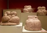 "These four ""fat folk"" figures were found in Apse 2. They may represent a later stage in the design of obese figures because they have no identifiable gender and have been reduced to standard poses and body forms. They could embody gods, goddesses, or leaders, or they might merely be symbols of prosperity. However, the fact that their heads were removable (many heads have been found separately) may imply that they were interchangeable so that individual features of different gods or leaders could be represented. Then again, maybe it was just safer to add the fragile, free-standing head after the heavy body had been moved into place."
