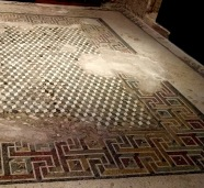 "Two kinds of tile were used to create this mosaic, found on the floor of a room thought to be a ""tablinum"" (reception room). Tiny square ones make up the Greek key or ""swastika"" border, while lozenge-shaped ones create an optical illusion of 3-D cubes, similar to an M.C. Escher painting. The floor in the dining room of our hotel in Valletta had a modern reproduction of this same central pattern. Everything old becomes new again."