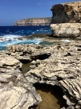 "Around the bend from the remnants of the Azure Window, you'll find ""The Blue Hole."" You can swim in it, but it's also a diver's paradise, with access to an underwater cave."