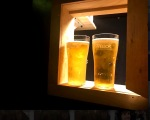 Frosty beers get funneled through a little window.