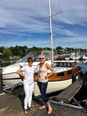 Leslie and I attempt to strike a nautical pose in front of her adorable boat. Behind us you can see one of the public marinas, where walking the piers gives you a view of everything from fancy yachts to sweet little dinghies.