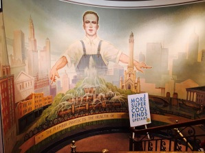 "Gotta love this WPA-style mural, which humbly reminds union members that ""The plumber protects the health of the nation."" The White Castle-like building on the right is the old Water Tower -- one of the few buildings to survive the Great Chicago Fire of 1871. In front of the plumber is Buckingham Fountain, known to Europeans as ""Bundy Fountain"" from the popular T.V. show ""Married with Children."" The show still airs daily in Norway."