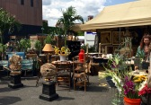 During the summertime, the huge parking lot surrounding the Plumbers Union Hall holds vendors selling everything from antiques and art to flowers, clothing, and artisan-made furniture.