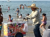 Here's another of my favorite things about Chicago's beaches: the paletas sellers. They roam up and down the beach ringing a row of little bells that dangle from their cart to let people know they're coming with frozen treats. You can see they sell all the usual crap that kids like, but the real paletas are far better.