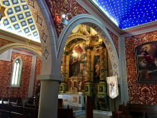 You'd never know from the church's rather sedate exterior that its interior is a riot of color and pattern. Frescoes from the 16th and 19th centuries blanket every available square inch of wall space. Check out the gorgeous 18th-century Baroque altar with twisting Solomonic columns.