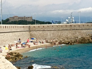 You can see the top of a super-yacht peeking up over the ramparts along Plage de Gravette.