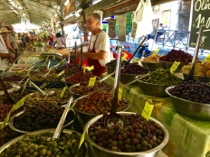 Check out the variety of olives available -- different mixes, different marinades, etc. Sampling is encouraged by vendors, but haggling isn't.