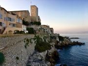 "along the coastline to offer one of the most famous views of the French Riviera -- that of Château Grimaldi and its ""Saracen Tower."""