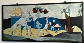 "In the painting ""Joie de Vivre (Antipolis),"" fauns, satyrs, and a big-breasted woman (Picasso's nubile girlfriend, French artist Françoise Gilot) cavort nude in nature. Some art critics say the painting represents not only Antibes's classical roots, but also Picasso's ebullience after WWII. Others say he intended to mock a painting of the same name created by his rival Matisse, who'd expressed the bourgeois attitude that art should be pure, serene, and ""devoid of troubling or depressing subject matter."""