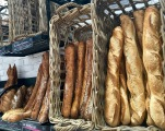 Just a small sampling of the many baguette-style breads available in one of the more permanent stalls that line the market's perimeter. The vendor here (one of our faves) also had rows of round breads, croissants, and pastries on display. To. Die. For.