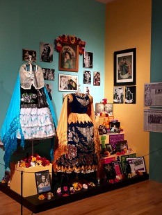 Another ofrenda honors Raquel Ontiveros, a famous Mexican folkloric dancer in Chicago. It also contains traditional elements, such as photos of the deceased and some of her favorite possessions, including her costumes, awards, and newspaper clippings highlighting her performances.