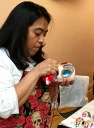 Here, the artist uses icing to paint a name on the forehead of a calaveras purchased by a friend of mine. She wanted to honor her recently departed dad by creating her own ofrenda at home.