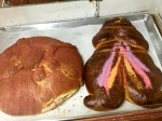 Here's another closeup showing different kinds of the Pan de Muertos. They all taste somewhat similar, but it's fun to see the different details.