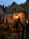 Another home chooses a more friendly decorative approach of happy Jack-o-lanterns, twinkling white lights, and my favorite -- glasses of mulled wine for the neighbors.