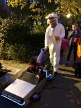 """Homemade costumes are the best. This guy has turned his son's pushcar into the DeLorean from the movie """"Back to the Future."""" He's Doc and his boy is Marty McFly."""