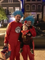Dr. Seuss's Cat in the Hat, plus Thing 1 and Thing 2. Wins the award for best way to use a baby to get free candy.
