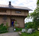 "It's traditional for every home to strap a birch sapling (called a ""koivu"" in Finnish) on either side of the entrance, as can be seen here in this historic Finnish house at Seurasaari. The saplings represent good luck in the coming year and provide protection and welcome to visitors passing between them."