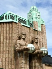 Four brawny males, two on either side of the main door, represent Finnish farmers. Stylistically speaking, they have one foot rooted in the organic naturalism of Art Nouveau and the other planted in the geometric abstractions of Art Deco.